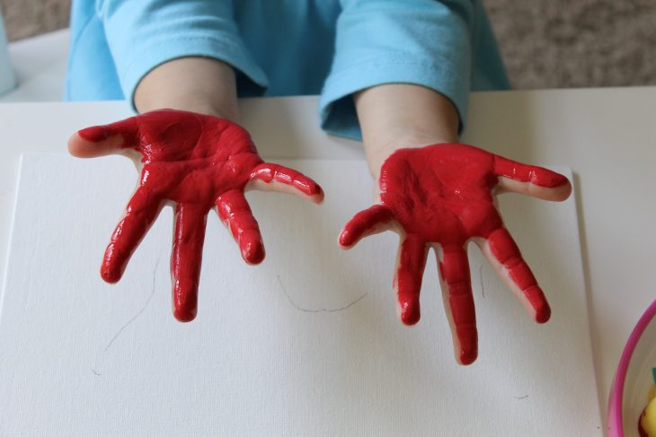 little kid hands painted red