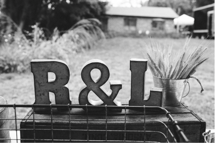 Steel Monograms R & L on Table at Outdoor rehearsal dinner