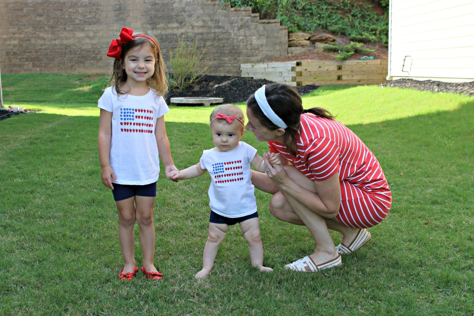 mom with daughters in red white and blue