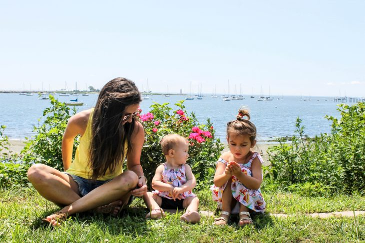 Woman sitting with baby and girl on Connecticut Coast