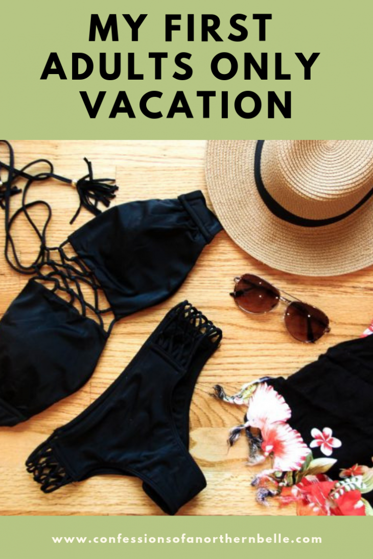 Black Bathing Suit Flat Lay with Sunglasses, Floral sarong, and Straw Beach Hat