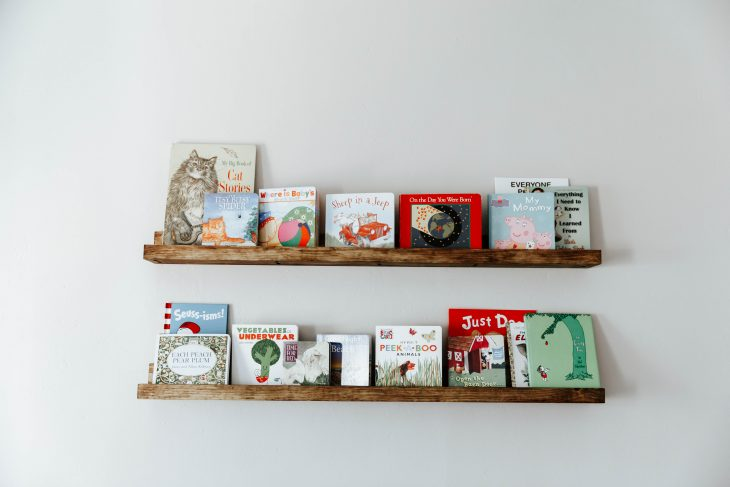 floating wooden bookshelves in nursery