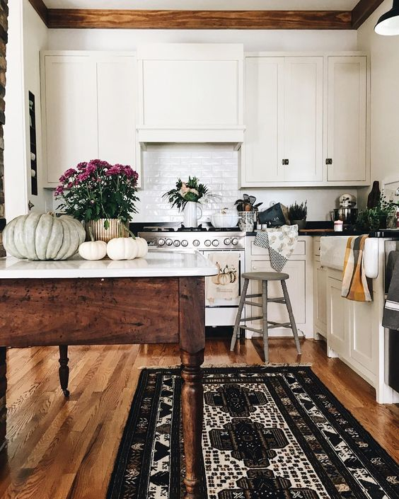 White Kitchen with Wood Floors and Counters