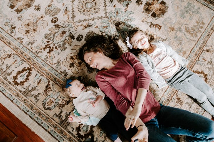 Mom and Daughters Laughing on the Floor