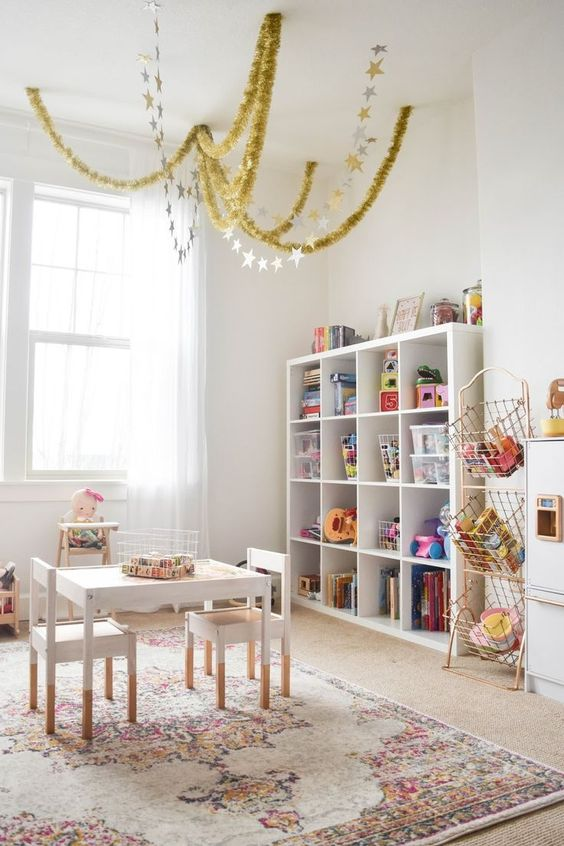 Girls Playroom with White Furniture and Stacking Shelves