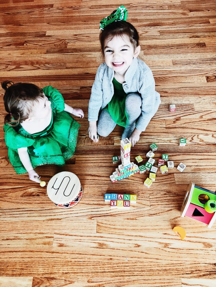 Kids playing with wooden toys
