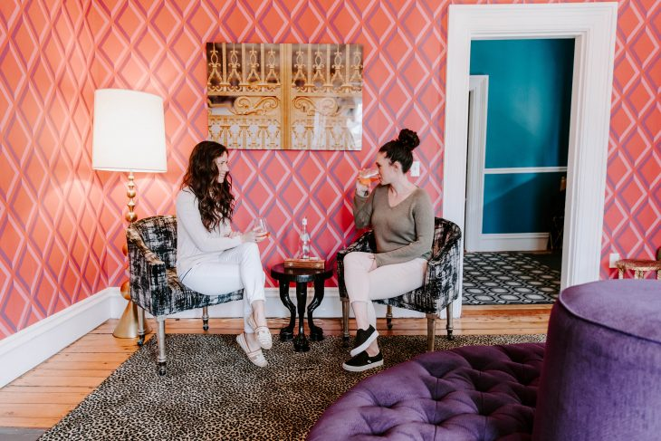 Pink room with purple and teal furniture girls drinking rose