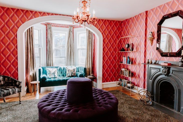 Pink room with purple and teal furniture