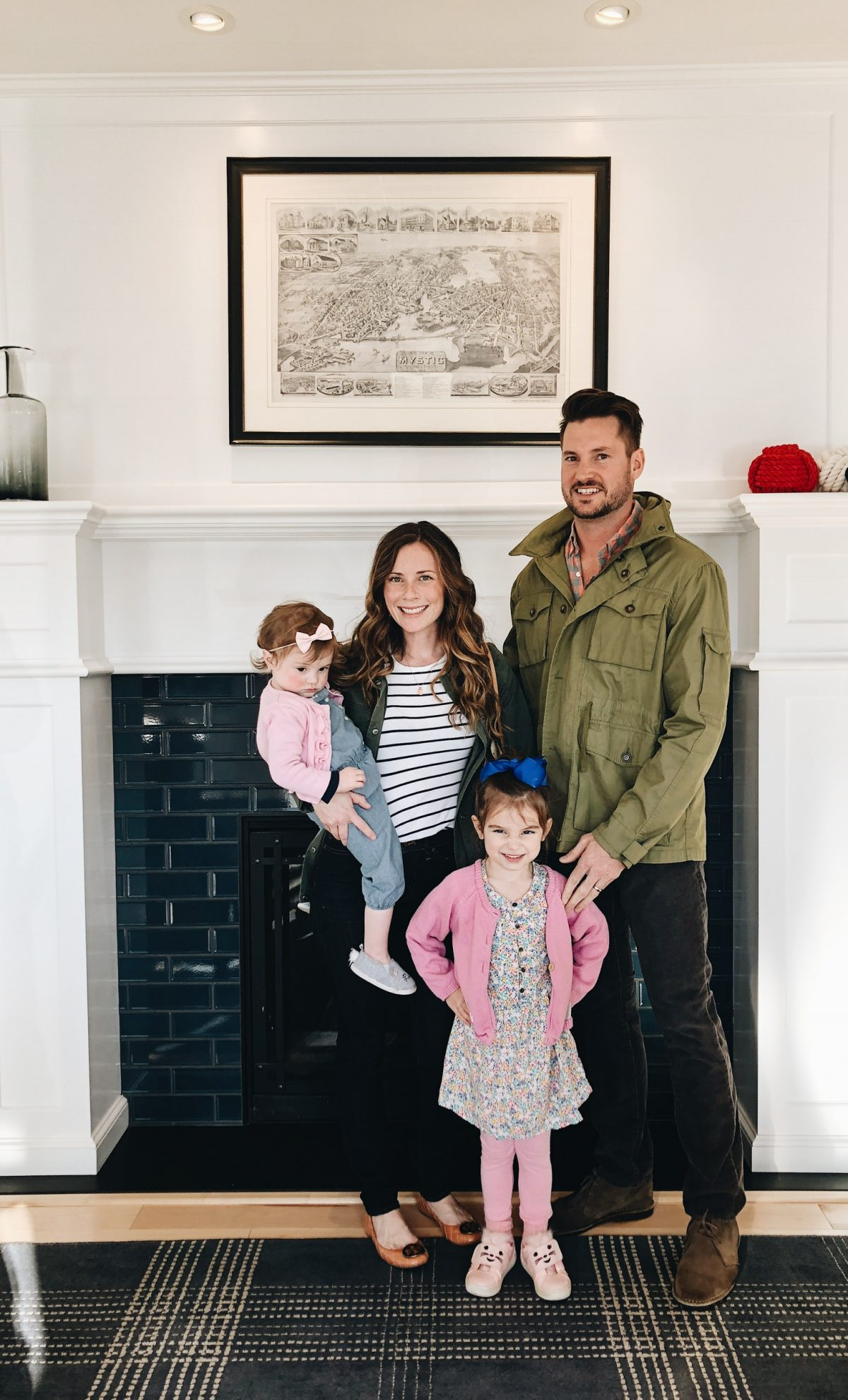 Family Photo in front of Fireplace