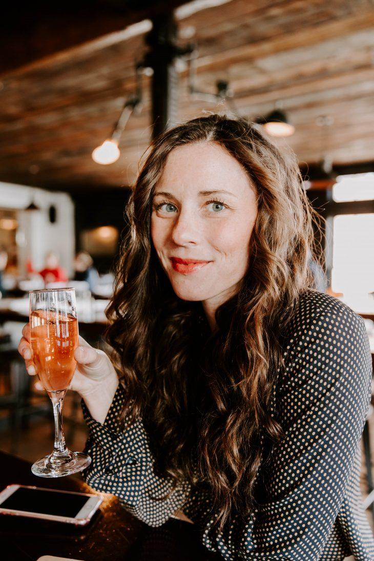 Woman sipping Rose at Midtown Oyster
