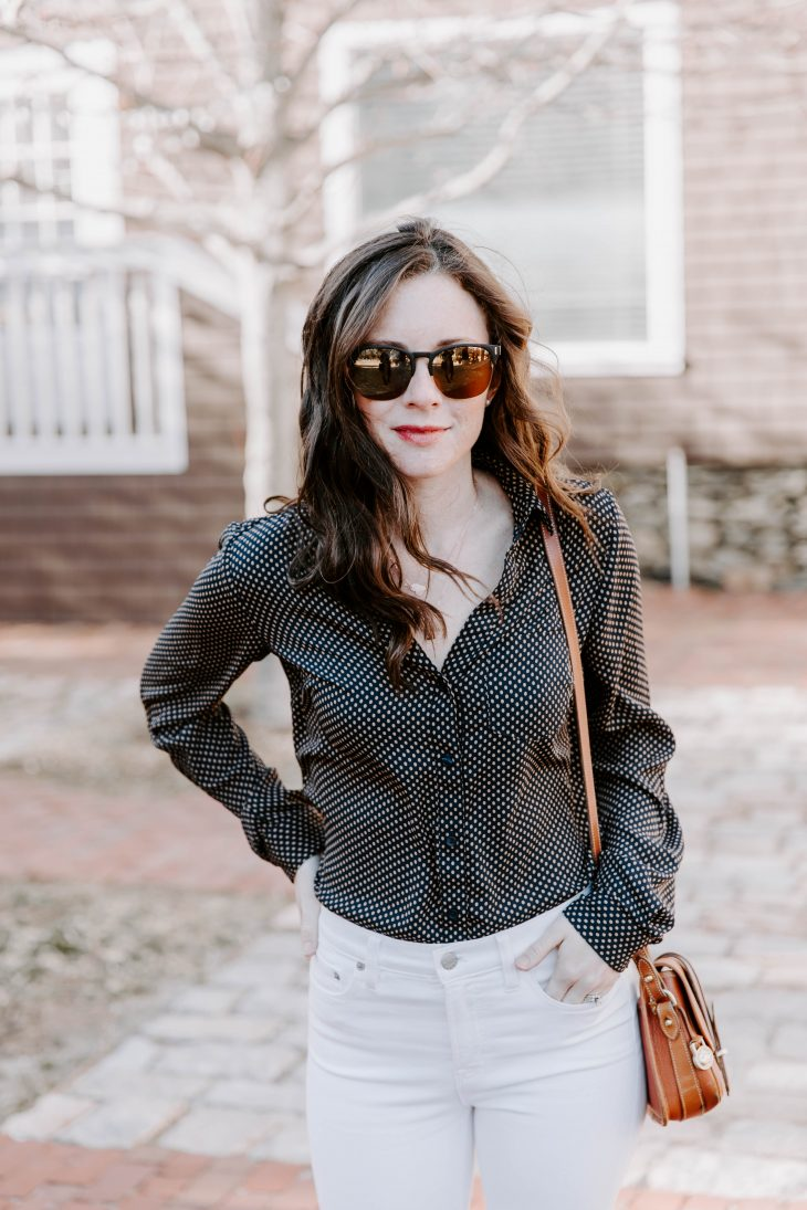 A Mommy blogger wearing a polka dot blouse