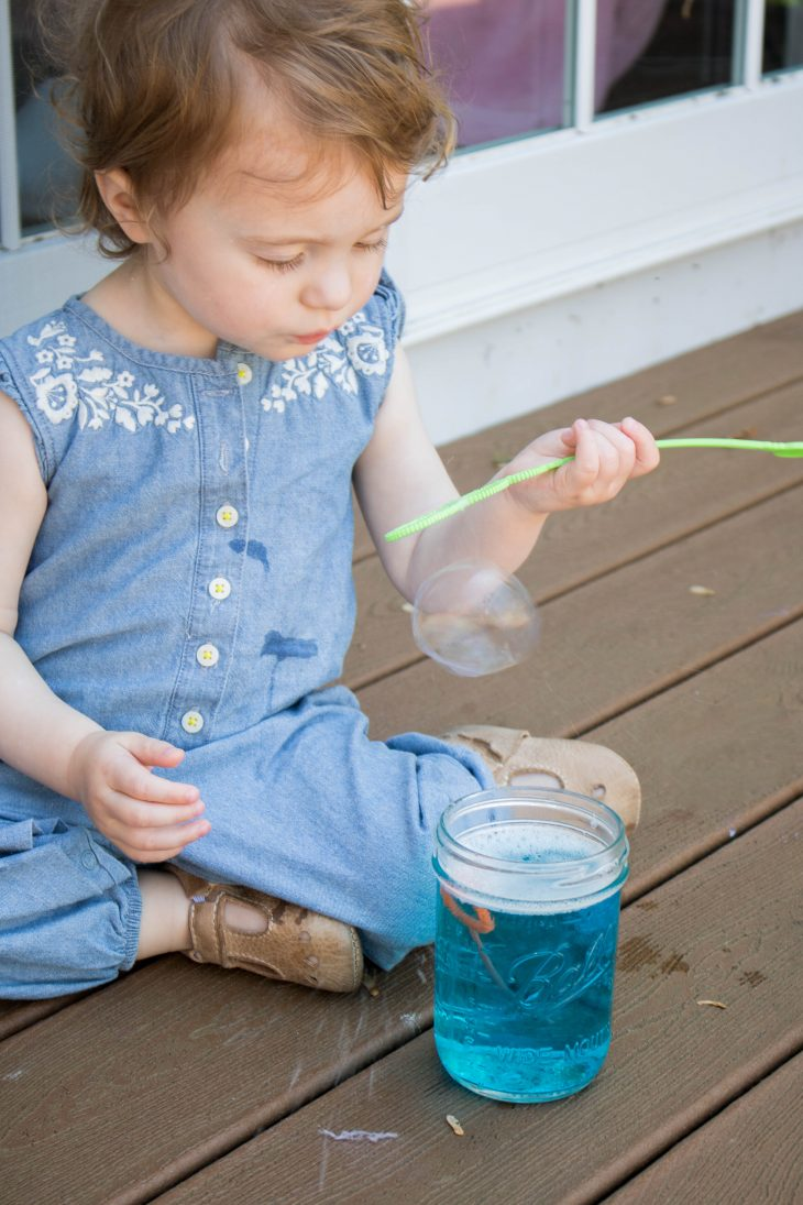 Baby Blowing Bubbles