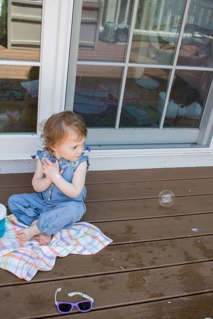Baby clapping over Bubble