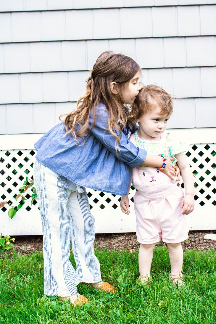 Sisters hugging and kissing - How to Handle Sibling Fights