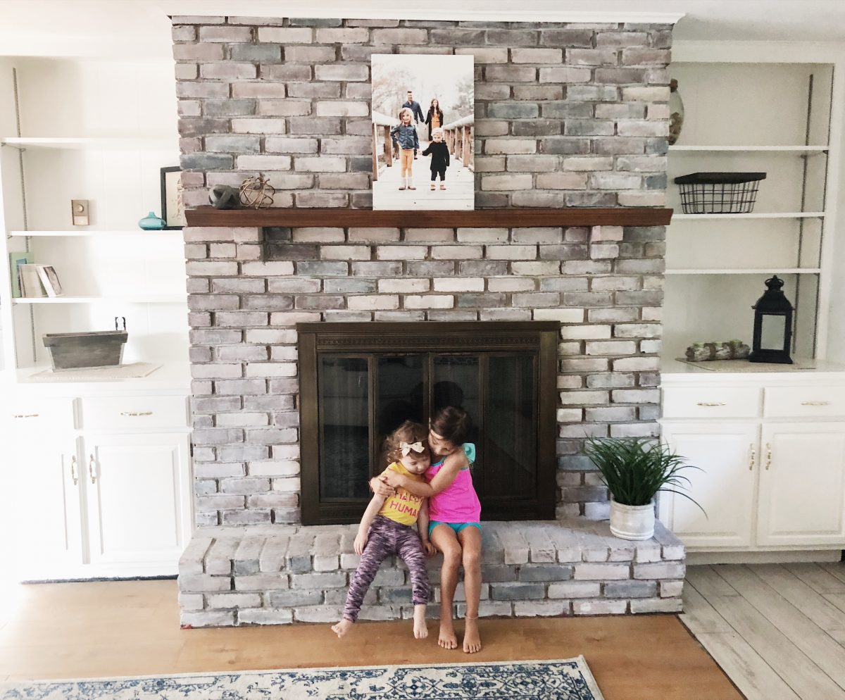whitewash fireplace and white built ins after upgrade