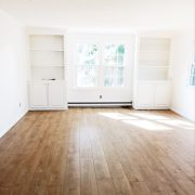 White Family Room with Wood Floors