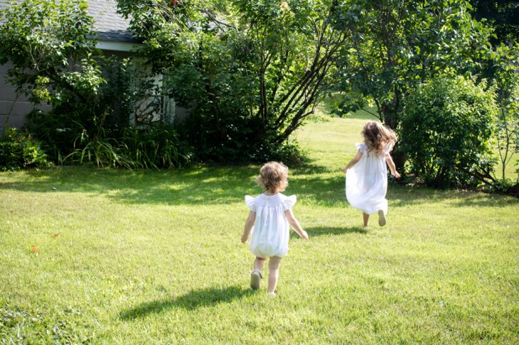 children running in the grass