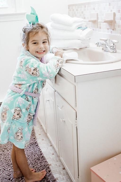 Little Girl Washing Hands in Bathroom