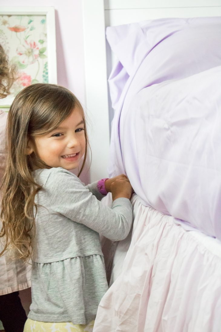 Little Girl Making her Bed, Purple Sheets