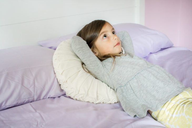 Little Girl Daydreaming in Bed