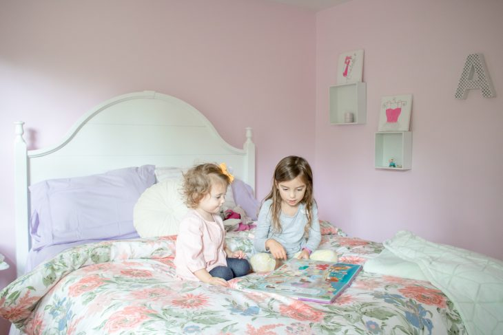 Sisters Playing on Bed