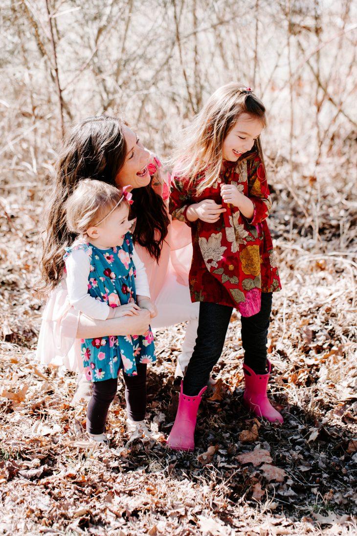Mom Hugging Daughters