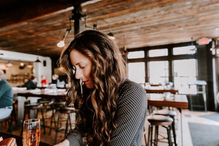 Woman Drinking Rose at a Newport Bar
