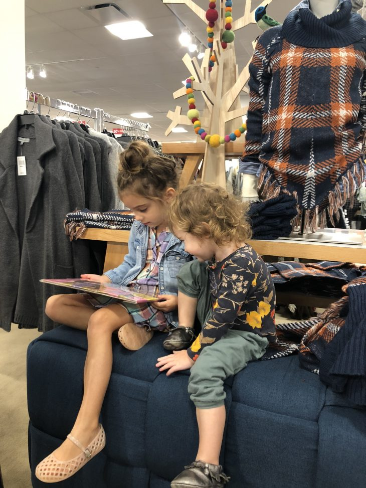 Boscov's - Sisters Reading on the Couch While Mommy Shops