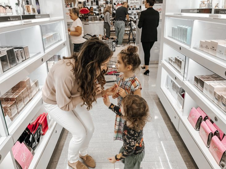 Mom and daughters smelling perfume