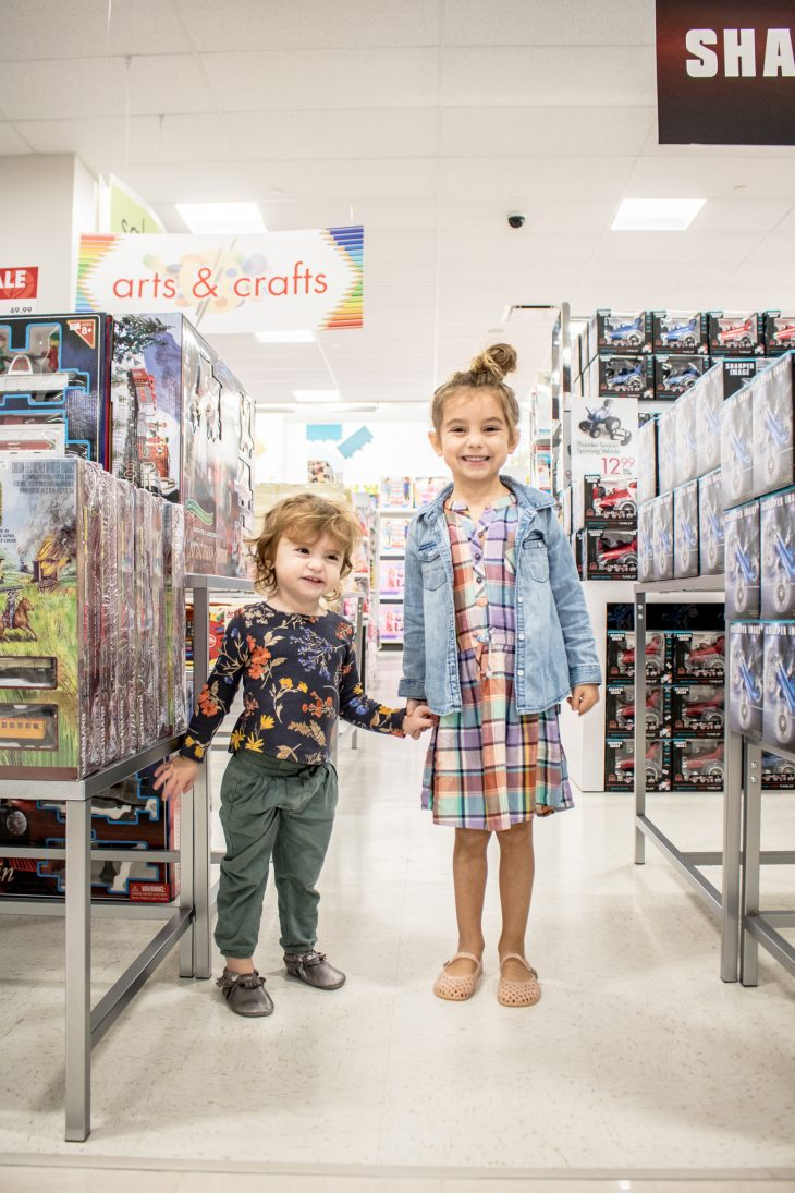 Toddlers in the Toy Section during a Mother-Daughter Shopping Trip