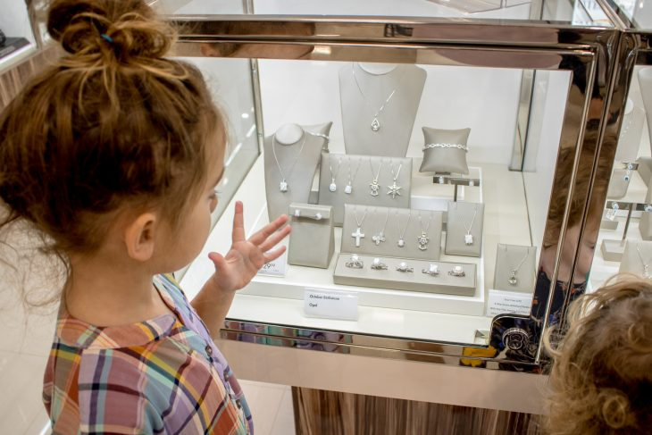 Little Girl at Jewelry Counter