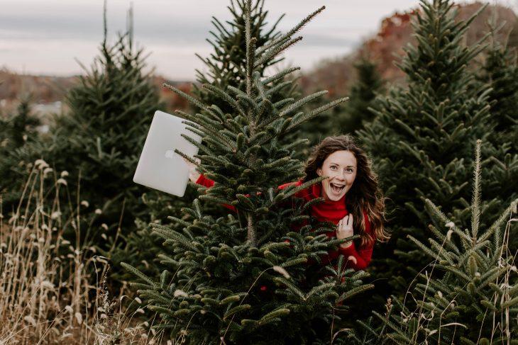Woman behind Christmas Tree in Dudley Stephens