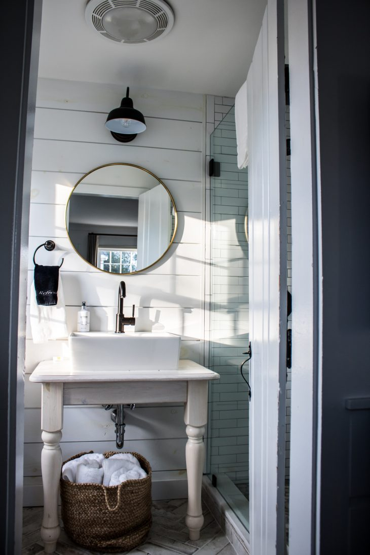 White Subway Tile Bathroom with Dark Fixtures