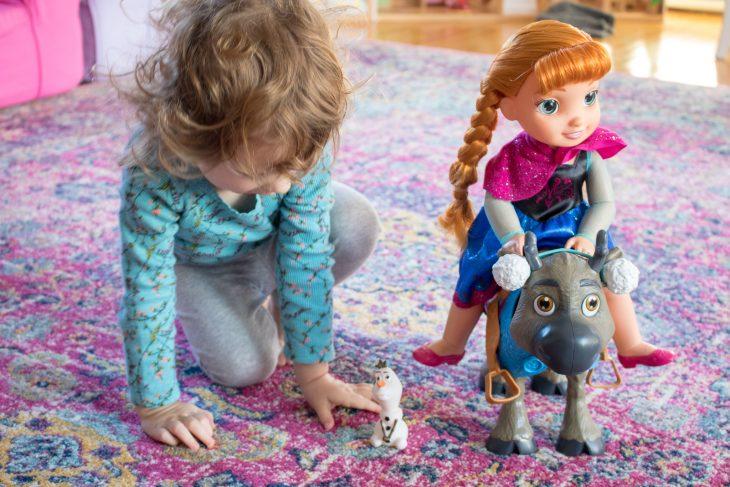 Little Girl with Disney's Frozen Toddler Anna & Sven Set