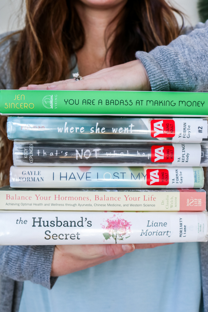 Books I'm Loving Lately - Woman Holding Books Between Her Hands