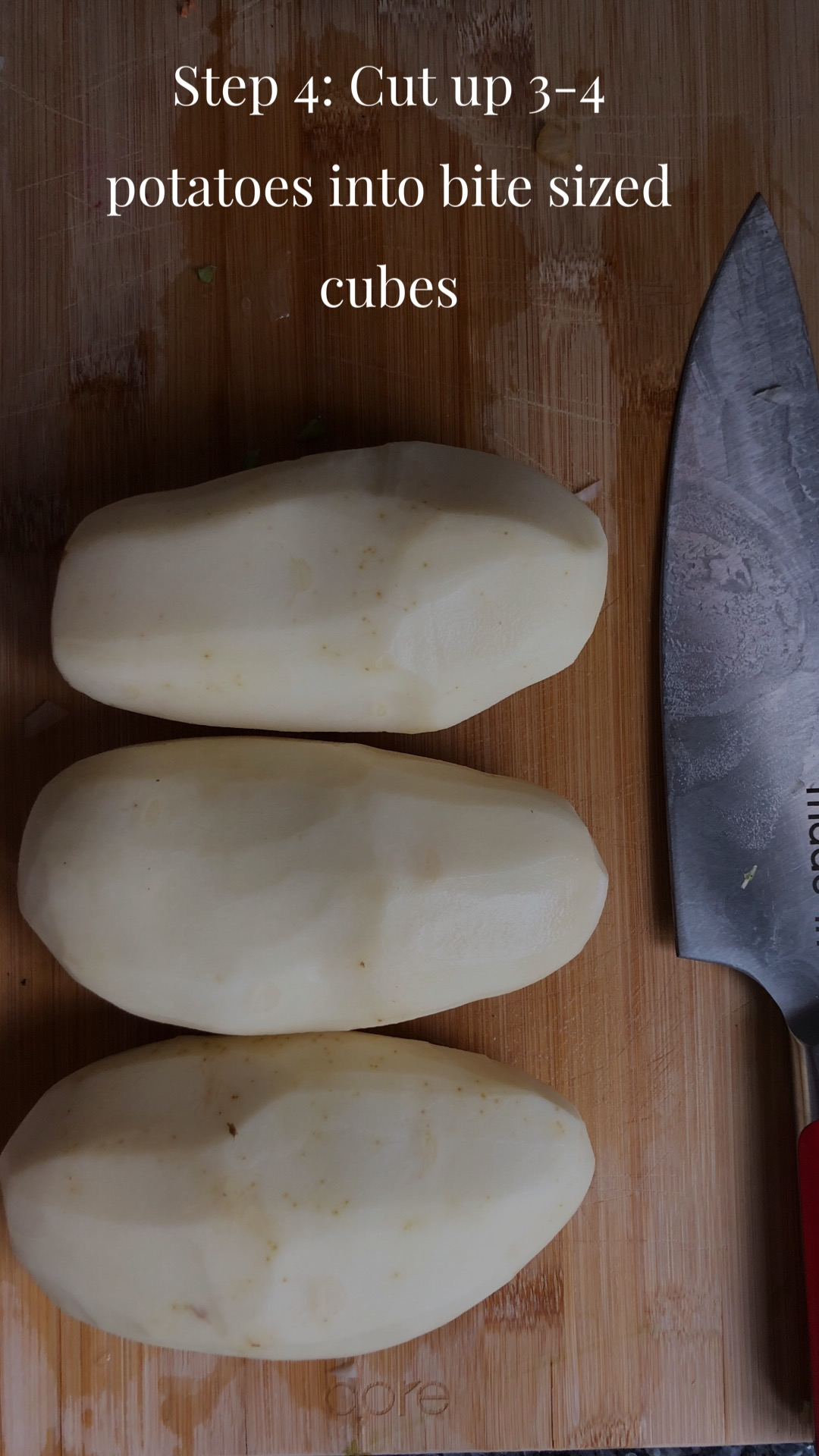 Three potatoes lined next to a knife