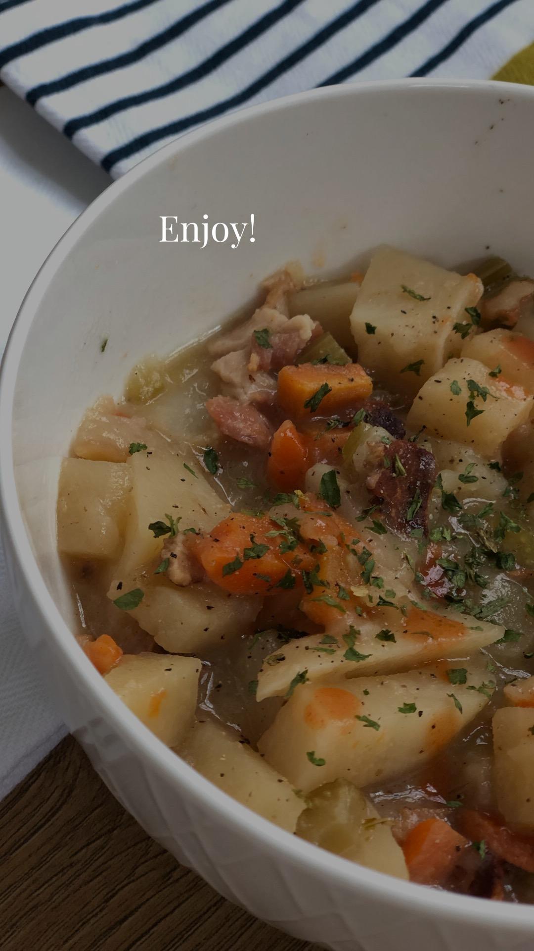 Potatos, carrots, bacon, parsley, celery soup in a bowl