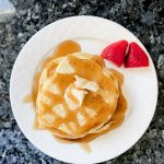 Homemade Pancakes topped with syrup and butter