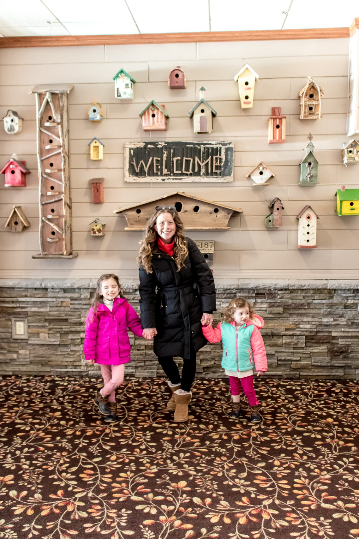 Mom and Daughters standing in main dining room at Woodloch