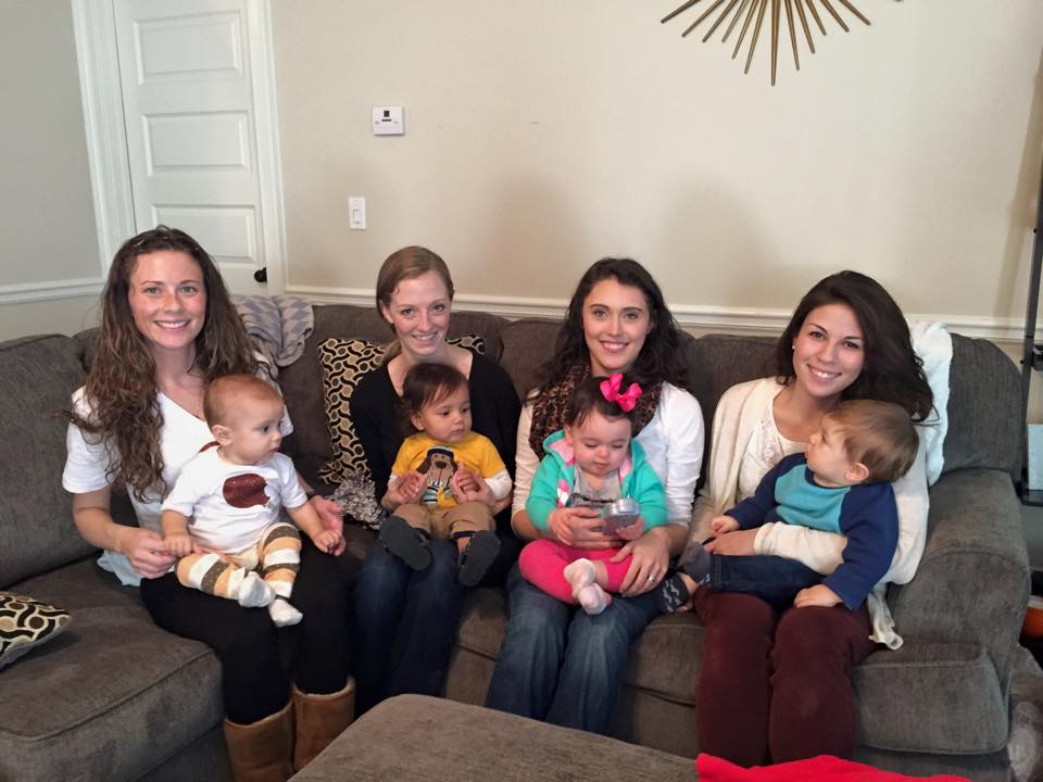 Young Moms holding babies