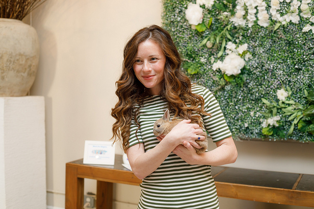 Caitlin from Confessions of a Northern Belle at NYC Product Launch for Baby Magic Holding a Baby Bunny
