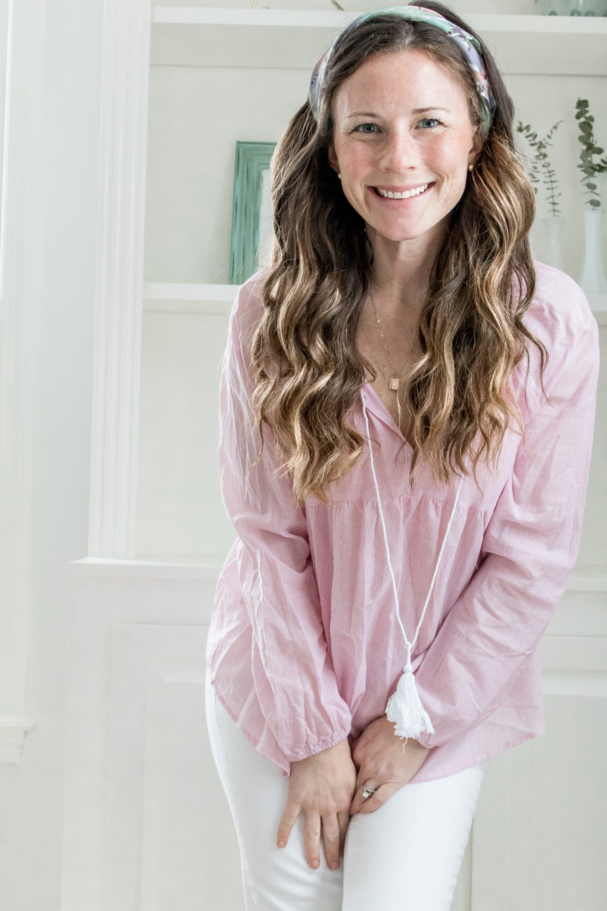Smiling woman in pink shirt white jeans cognac riding boots