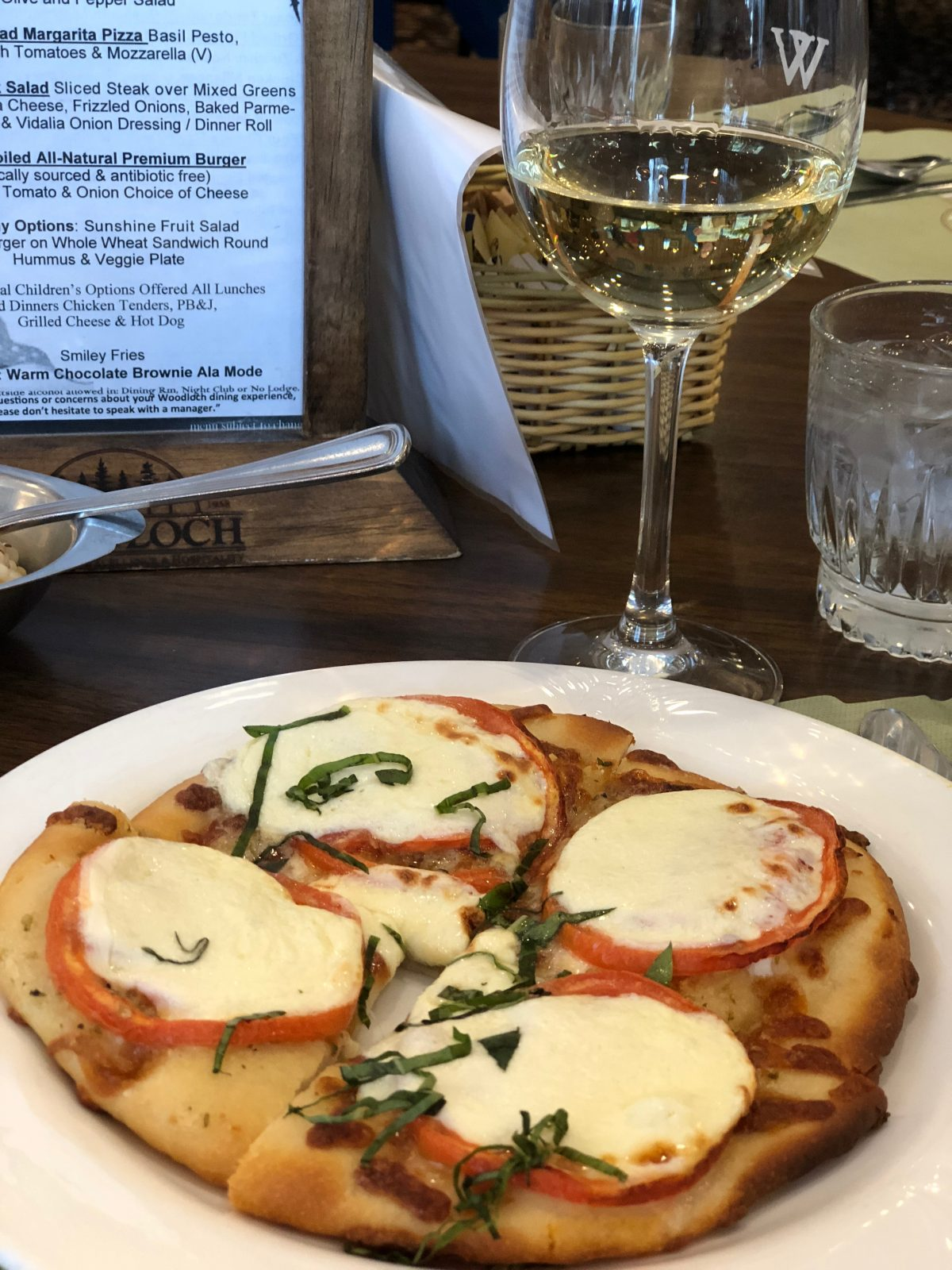 Fresh mozzarella tomato basil flatbread with glass of wine Woodloch Pines Resort in Pocono Mountains