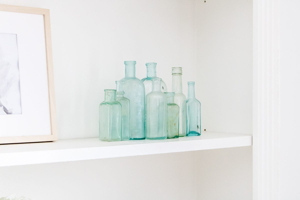 Blue glass bottles grouped on a shelf