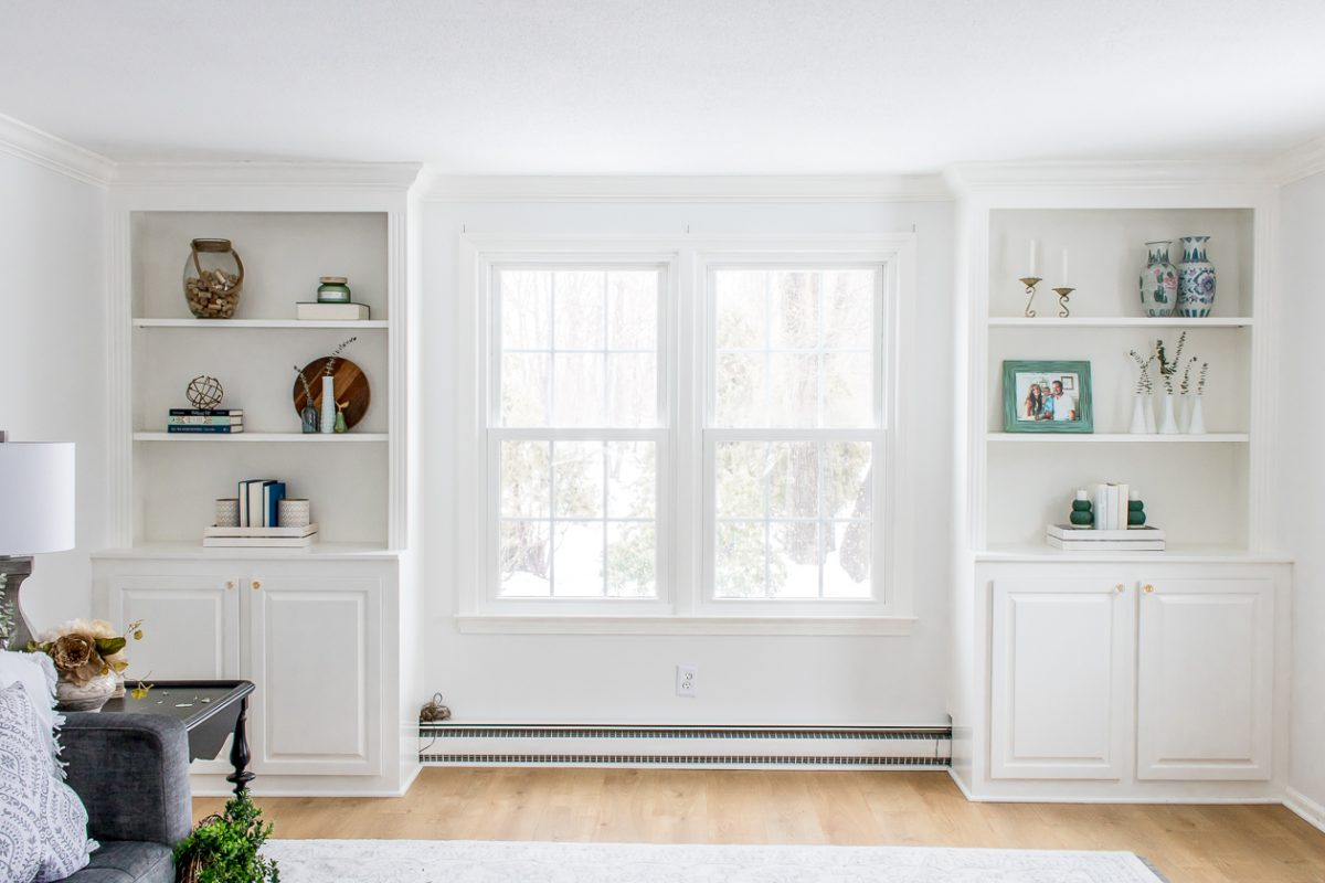 Decorated White Built In Bookshelves