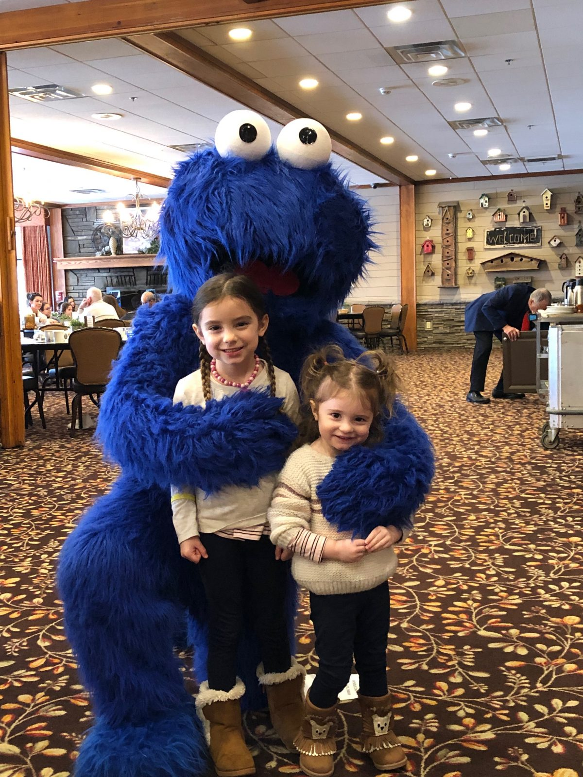 Little girls with Cookie Monster in the Dining Room at Woodloch Pines Resort
