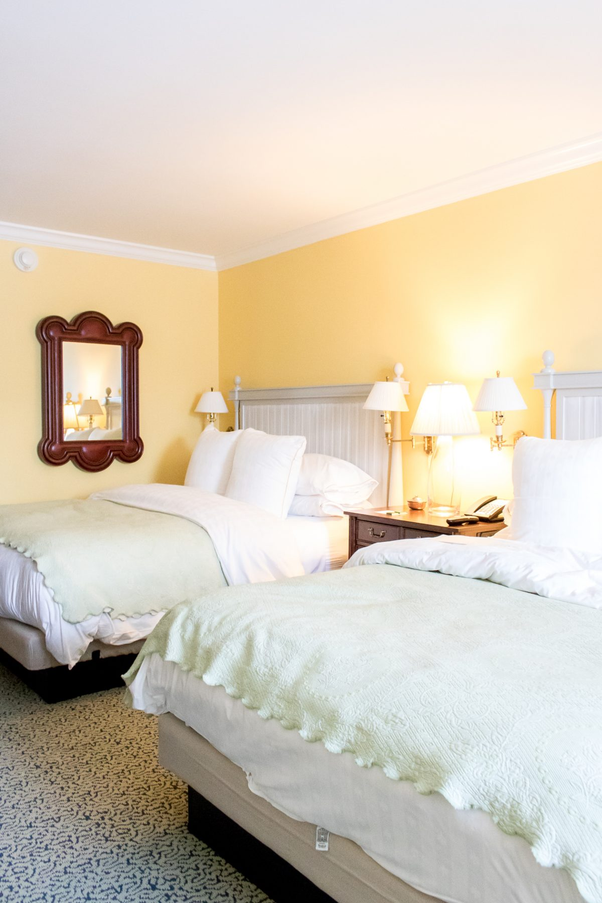 Queen Size Beds with Yellow Walls at Woodstock Inn and Resort in Woodstock Vermont