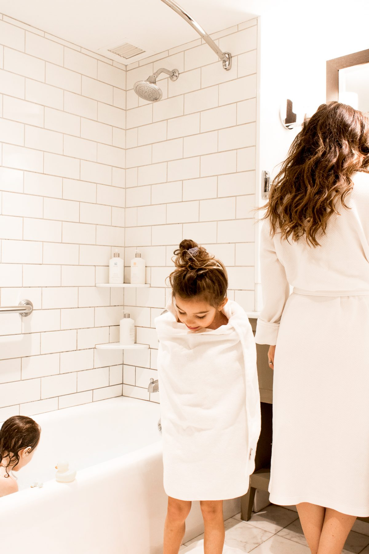 Mom and Daughters in Bathrobes and Towels at Woodstock Inn and Resort in Bathroom