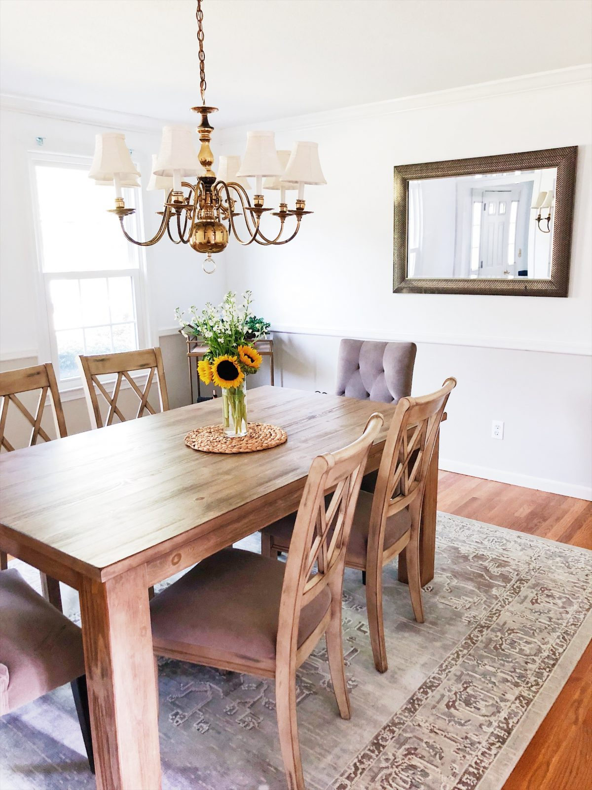 5 light Shaded Gold Chandelier over dining room table with sunflower centerpiece