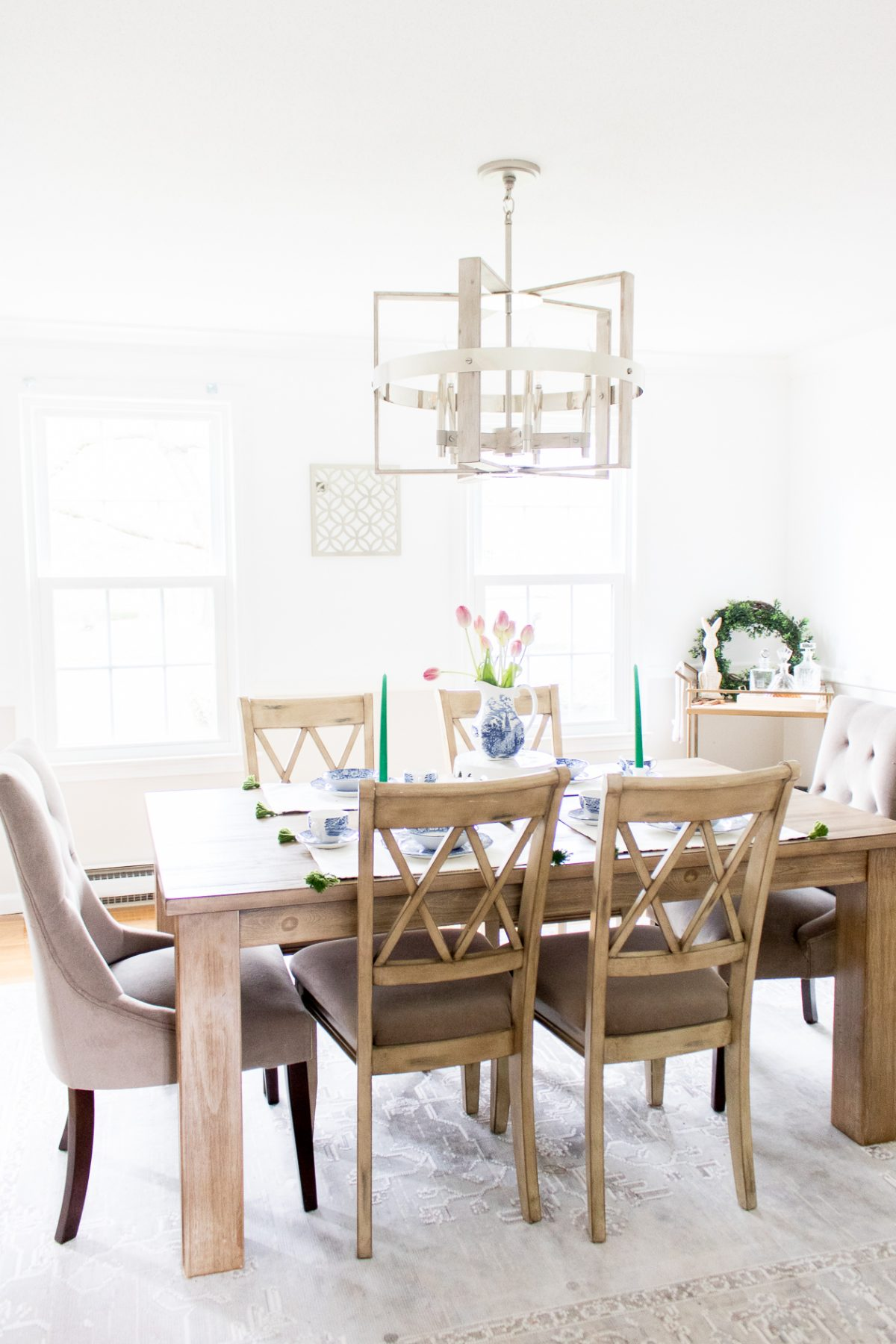 Peyton 5 Light Chandelier in White Washed Wood over dining room table set with blue china and tulip centerpiece